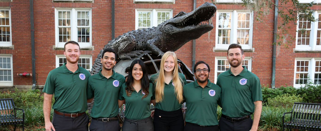 Group of students in front of the Gator Ubiquity statue